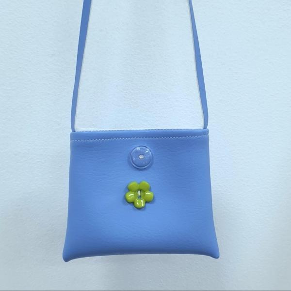 Cornflower blue handbag showing button motif. This is variable but always complimentary