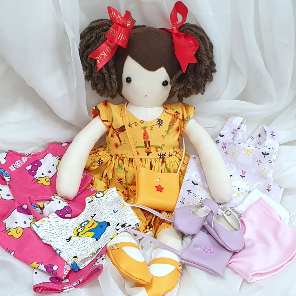Doll with new outfits ready to meet her new family