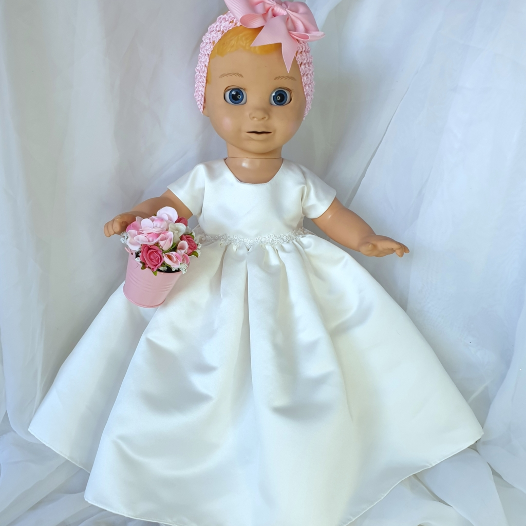 Luvabella wearing a Kornwell Kidz gown