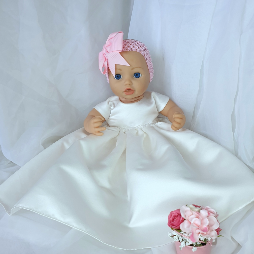 Baby Annabell wearing a Kornwell Kidz gown